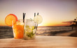 Summer drinks with blur beach on background - 65375588