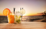Fototapety Summer drinks with blur beach on background