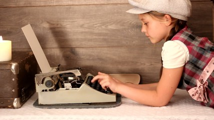 little girl typing on a typewriter, retro styling