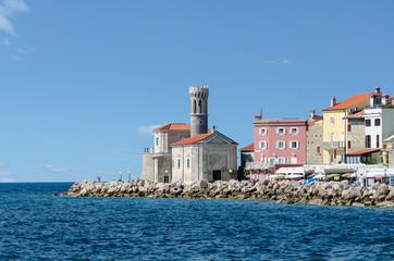 Leuchtturm am Meer in Piran