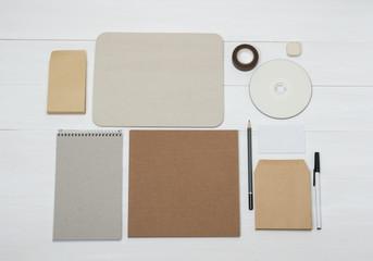 Business Identity Mockup Item Set On White Wooden Desk