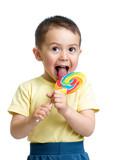 Fototapety kid boy eating lollipop isolated