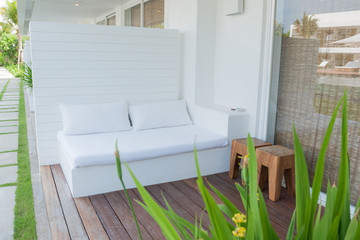 sofa near swimming pool