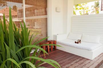 sofa near swimming pool