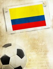 Photo of Colombia flag and soccer ball