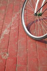 bike on red brick road in sun light