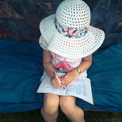 Girl doing her homework in the garden