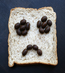 Bread slices with face of coffee beans