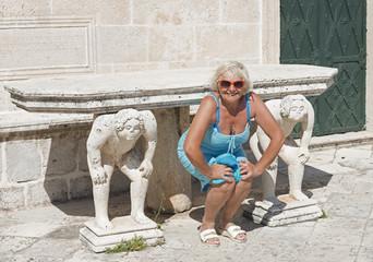 Woman posing for imitating the memorial sculptures.