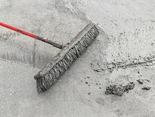 Resurfacing the pavement with broom and tar