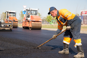 Construction Worker during Asphalting Road Works