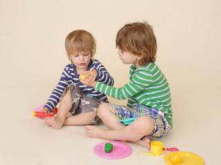 Children Sharing Pretend Food