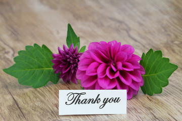 Thank you card with purple dahlia on wooden surface