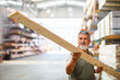 Man buying construction wood in a  DIY store