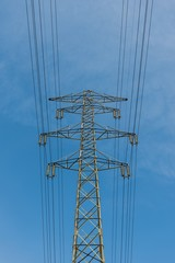 Large electric pylon with blue sky