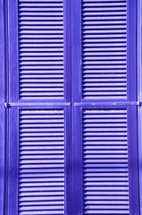 Window of a house closed with wooden shutters. Tel Aviv.