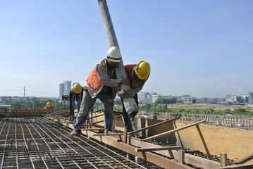 Two Construction Workers Doing Concreting