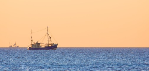 Lonely trawler boats at dusk