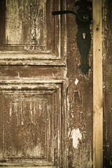Closeup old wooden door with metal handle