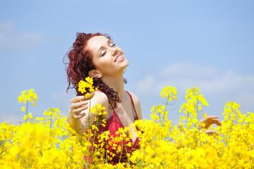 Woman enjoying in a rape field