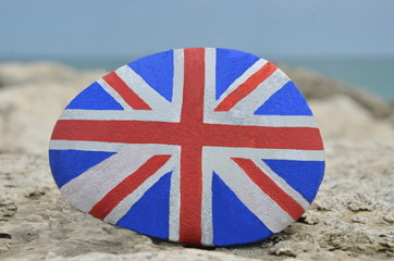 British flag painted on a stone on the rocks