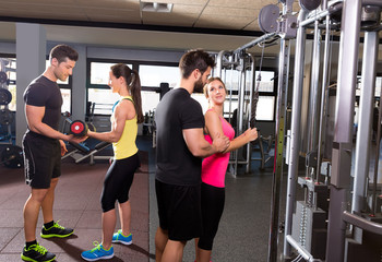 cable pulley system gym and dumbbell fitness people