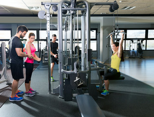 cable pulley system gym workout fitness people