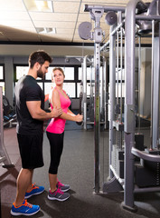 cable pulley system personal trainer man and woman