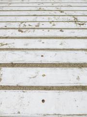 Detalle de sendero de madera en playa