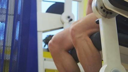 Pulling weight machine at gym