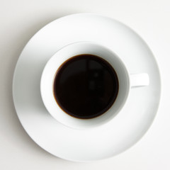 Cup of black coffee on saucer,