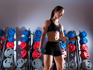 Dumbbell woman workout fitness at gym