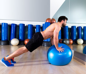 Fitball abdominal push ups Swiss ball man