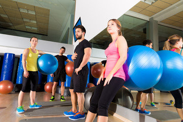 Gym people group relaxed after fitball training