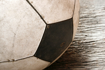 Old Soccer football on old vintage wood table