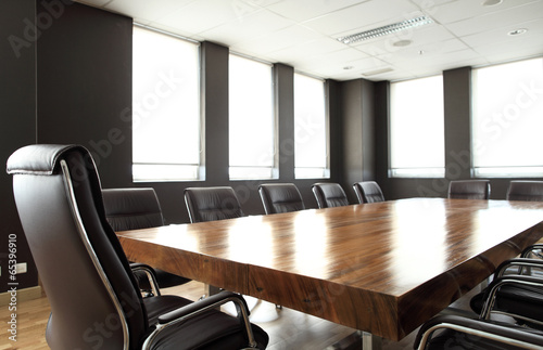 Modern meeting room with solid wood table - 65396910