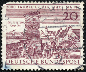 stamp shows Drusus Stone and Old View of Mainz