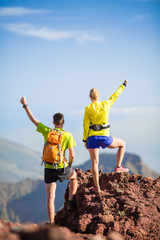 Couple hikers or trail runners in mountains