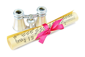 Opera glasses and roll with musical notes