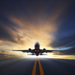 canvas print picture - passenger plane take off from runways against beautiful dusky sk