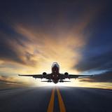 passenger plane take off from runways against beautiful dusky sk - 65404981
