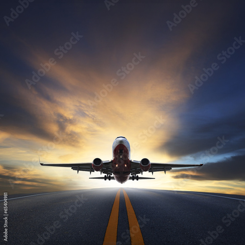 Poster passenger plane take off from runways against beautiful dusky sk