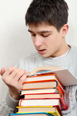 Teenager reads a Books