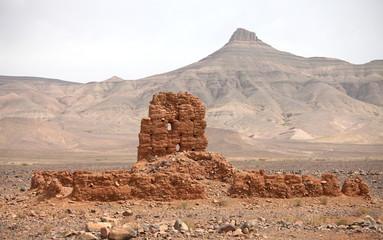 Ruins of clay building near Atlas mountains, Morocco