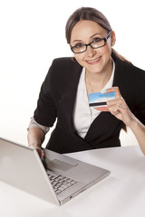 Happy Woman shopping online with credit card and laptop