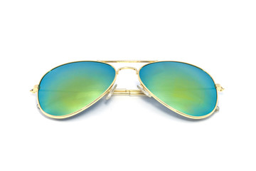 Gold sun glasses have a lens glass green yellow reflecting on an