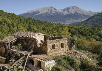 A ruined out leaning old abandoned house on mountain in Greece
