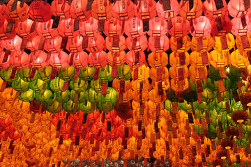 Many red, yellow and green glowing lanterns on Buddha's birthday