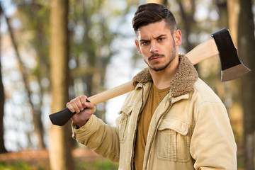 strong lumberjack man holding axe