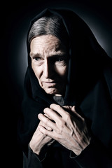 Sad old woman senior in sorrow